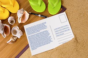 Escribir postal personalizada desde la playa